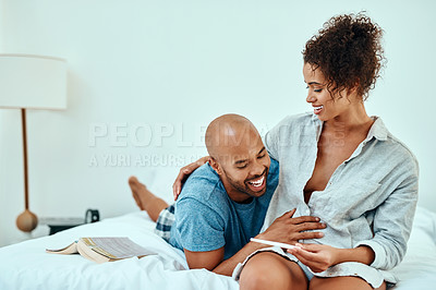 Buy stock photo Shot of a young couple taking a home pregnancy test