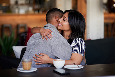 Buy stock photo Shot of a young couple hugging on a date in a cafe
