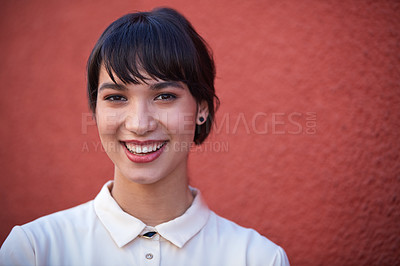 Buy stock photo Portrait of a young businesswoman standing against a red wall outdoors