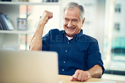 Buy stock photo Cropped shot of a senior businesman working from home
