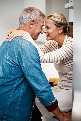 Buy stock photo Cropped shot of a loving couple in the kitchen