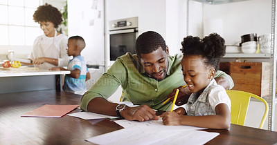 Buy stock photo Cropped shot of a young handsome father helping his daughter with her schoolwork at home