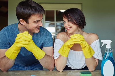 Buy stock photo Shot of a young couple doing chores together at home
