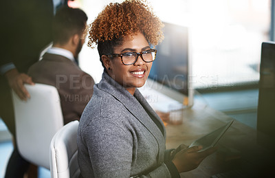 Buy stock photo High angle portrait of an attractive young businesswoman working at her desk in a modern office