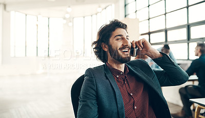 Buy stock photo Shot of a young businessman using a cellphone in a modern office