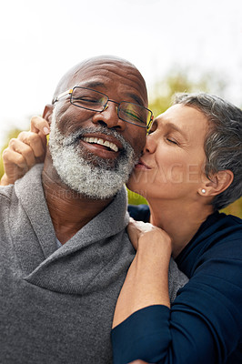 Buy stock photo Cropped shot of an affectionate senior couple enjoying some quality time in the park