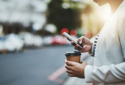Buy stock photo Closeup shot of an unrecognizable businesswoman using a cellphone in the city