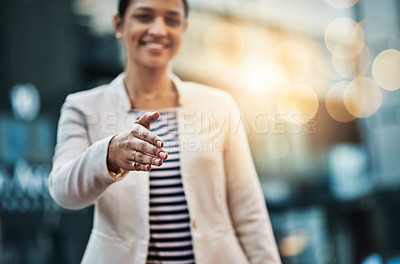 Buy stock photo Closeup shot of a young businesswoman extending a handshake in the  city