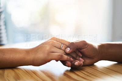 Buy stock photo Cropped shot of an unidentifiable man and woman holding hands on a table