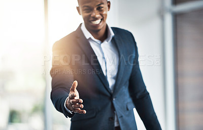 Buy stock photo Cropped portrait of a handsome young businessman offering his hand while standing in his modern office