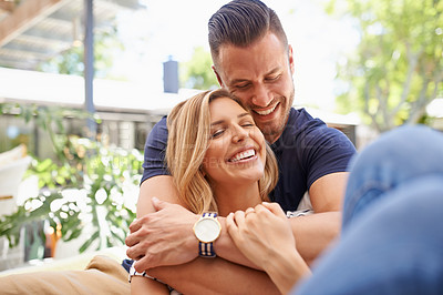 Buy stock photo Cropped shot of an affectionate and happy couple relaxing outside in their backyard