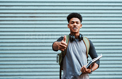 Buy stock photo Portrait of a university student showing thumbs up at campus