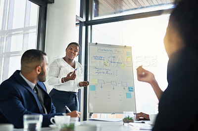 Buy stock photo Shot of a businesswoman delivering a presentation in the boardroom