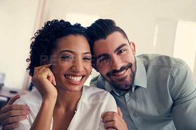 Buy stock photo Portrait of a young affectionate couple in the office