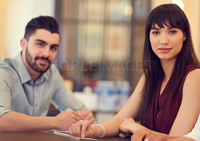 Buy stock photo Portrait of a young businessman and businesswoman in the office