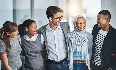 Buy stock photo Portrait of confident young business people standing with arms around inside of the office at work during the day