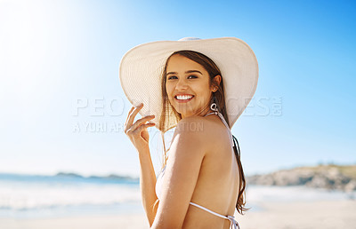 Buy stock photo Shot of a beautiful young woman enjoying the day at the beach