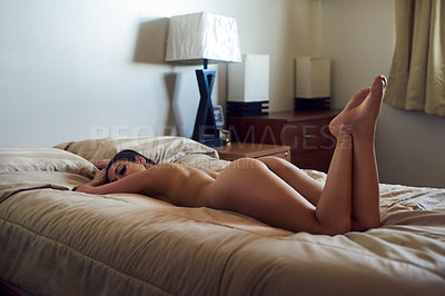 Buy stock photo Shot of a sexy young woman in her bedroom at home