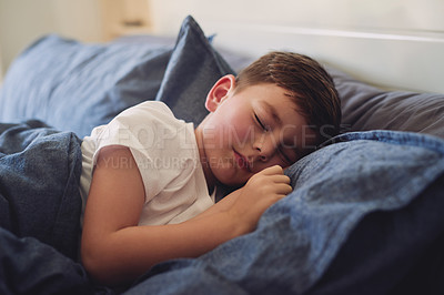 Buy stock photo Shot of an adorable little boy sleeping in bed at home
