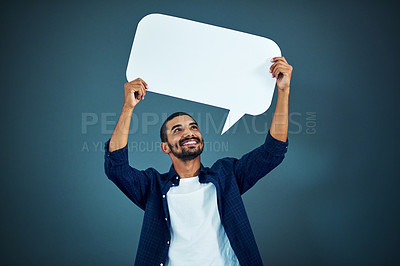 Buy stock photo Studio shot of a handsome young businessman holding up a speech bubble