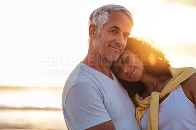 Buy stock photo Portrait of a mature couple sharing a romantic moment at the beach