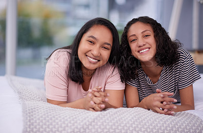 Buy stock photo Portrait of two teenage girls chilling at home
