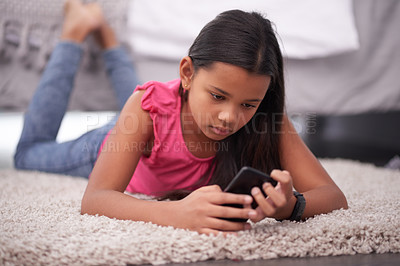 Buy stock photo Shot of a teenage girl using her cellphone at home