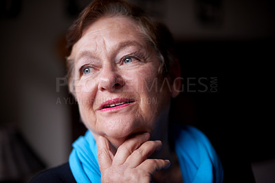 Buy stock photo Shot of a senior woman looking away thoughtfully at home
