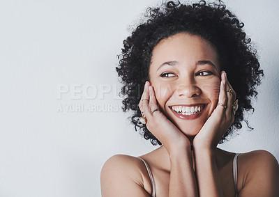 Buy stock photo Studio shot of beautiful young women posing against a grey background