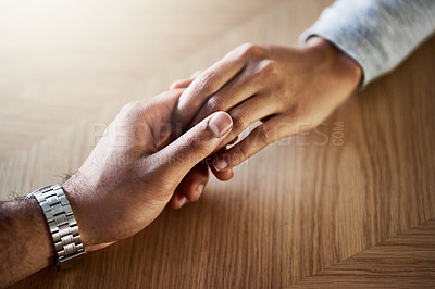 Buy stock photo Cropped shot of an unrecognizable couple holding hands