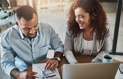 Buy stock photo High angle shot of a young couple planning their budget together at home