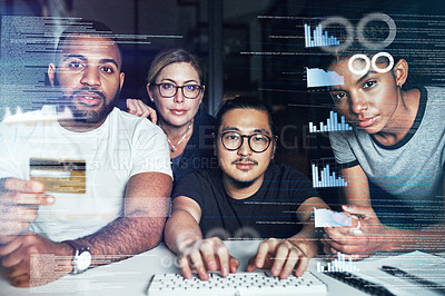 Buy stock photo Shot of a group of programmers using a credit card while working together on a computer code at night
