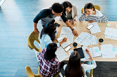 Buy stock photo High angle shot of a group of young students studying together at university