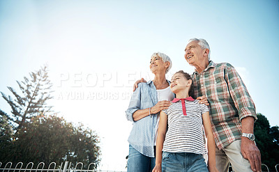 Buy stock photo Shot of an adorable little girl spending time with her grandparents in the park