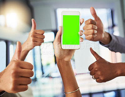 Buy stock photo Closeup shot of an unrecognizable group of businesspeople showing thumbs up to a cellphone with a green screen in an office
