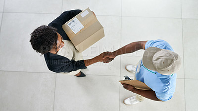 Buy stock photo High angle shot of a young delivery man shaking hands with a customer