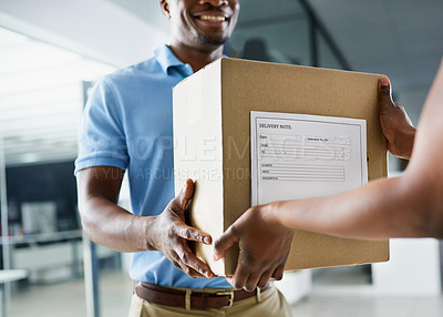 Buy stock photo Cropped shot of a woman receiving a package from a delivery man in a modern office