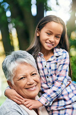 Buy stock photo Cropped portrait of an adorable little girl enjoying the day outdoors with her grandmother