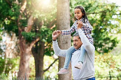 Buy stock photo Cropped shot of an adorable little girl riding on her granddad's shoulders while enjoying the day outdoors