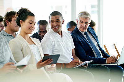Buy stock photo Shot of an audience of businesspeople at a conference