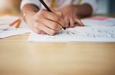 Buy stock photo Cropped shot of an unrecognizable young fashion designer working on her designs in her workshop