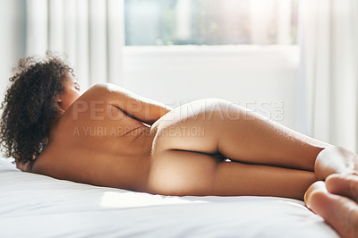 Buy stock photo Rearview shot of a woman wearing no clothes in her bedroom