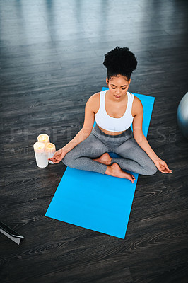 Buy stock photo Shot of a young woman practising a yoga position