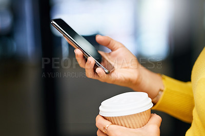 Buy stock photo Closeup shot of an unrecognizable woman using a cellphone while drinking coffee