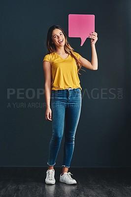 Buy stock photo Studio shot of a beautiful young woman holding a speech bubble