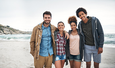 Buy stock photo Portrait of a group of young people spending a day at the beach