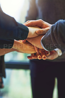 Buy stock photo Cropped shot of a group of unrecognizable businesspeople huddled together with their hands piled on top of each other in an office
