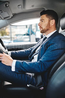 Buy stock photo Cropped shot of a handsome mature businessman driving himself to work