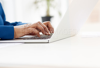 Buy stock photo Cropped shot of a businesswoman using a laptop at a work desk