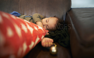 Buy stock photo Cropped shot of an adorable little girl sleeping on the sofa with a Christmas decoration her her hand